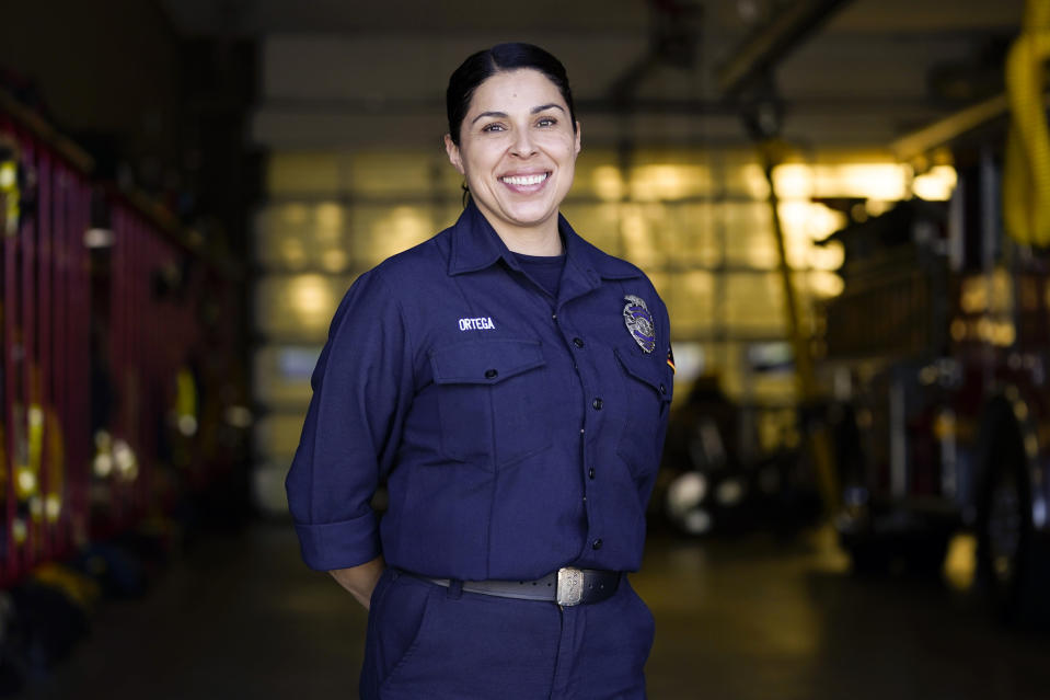 Firefighter paramedic Sally Ortega of Los Angeles County Fire Department - Station 106 poses for a photo at her station Friday, Feb. 26, 2021, in Rancho Palos Verdes, Calif, a suburb of Los Angeles. She was among first responders at the scene of a vehicle crash involving golfer Tiger Woods on Tuesday. (AP Photo/Ashley Landis)