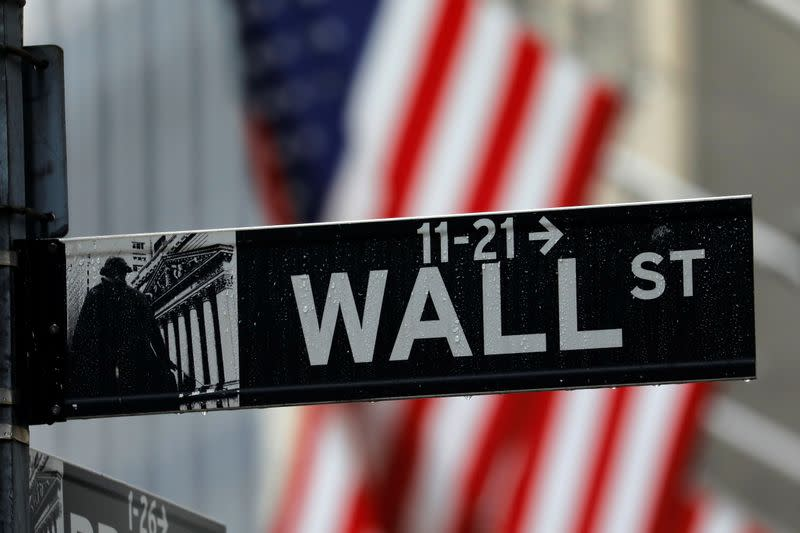 Raindrops hang on a sign for Wall Street outside the New York Stock Exchange in New York