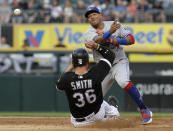 Toronto Blue Jays second baseman Yangervis Solarte, top, throws out Chicago White Sox's Tim Anderson at first after forcing out Kevan Smith at second during the third inning of a baseball game Saturday, July 28, 2018, in Chicago. (AP Photo/Nam Y. Huh)