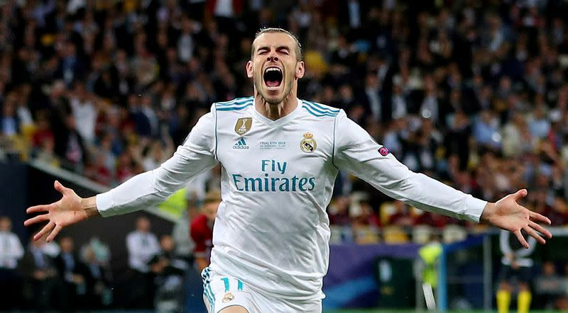 FILE PHOTO: Real Madrid's Gareth Bale celebrates scoring their second goal in a 3-1 Champions League final win over Liverpool. Bale's brace and errors by Liverpool keeper Loris Karius gave the Spanish side a third straight title in the competition.