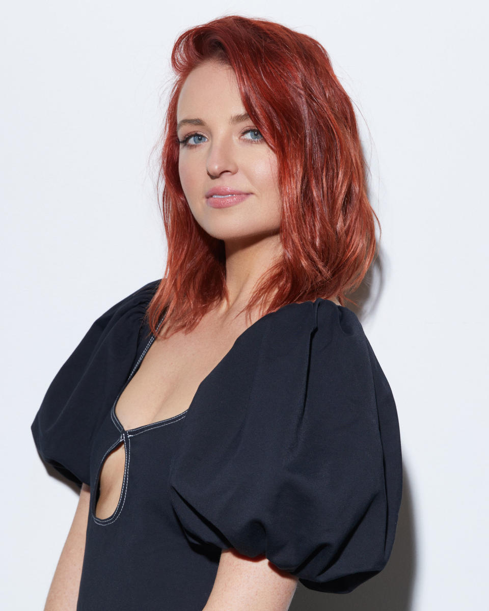 Headshot of Neighbours actor Charlotte Chimes wearing a black dress with puffy sleeves