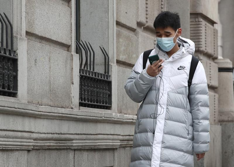 MADRID, SPAIN - JANUARY 28: An Asian boy walks down the street on the occasion of OMS elevates to ``high´´ the international threat from the Wuhan coronavirus on January 28, 2020 in Madrid, Spain. (Photo by Eduardo Parra/Europa Press via Getty Images)