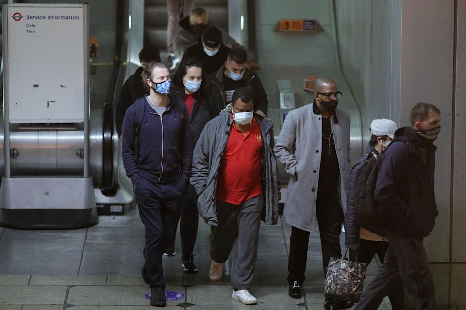 LONDON, Oct. 21, 2020 -- People wearing face masks walk at Canning Town tube and DLR station, in London, Britain, on Oct. 21, 2020. Another 26,688 people in Britain have tested positive for COVID-19, the highest daily increase ever since the pandemic began in the country, according to official figures released Wednesday. (Photo by Tim Ireland/Xinhua via Getty) (Xinhua/Han Yan/Tim Ireland via Getty Images)