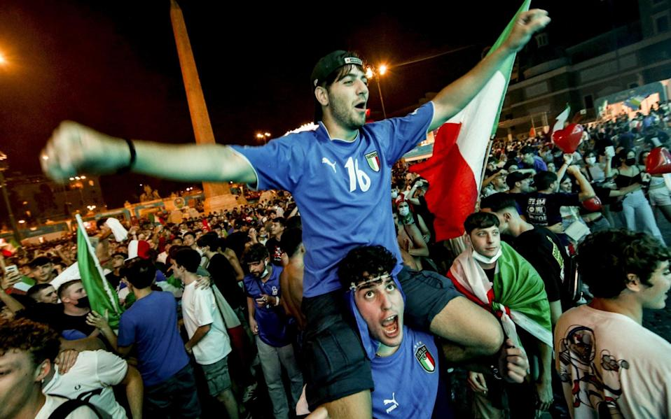 Italy fans celebrate their side reaching the quarter-finals - SHUTTERSTOCK
