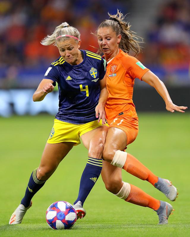 Hanna Glas of Sweden is challenged by Lieke Martens of the Netherlands during the 2019 FIFA Women's World Cup France Semi Final match between Netherlands and Sweden at Stade de Lyon on July 03, 2019 in Lyon, France. (Photo by Richard Heathcote/Getty Images )