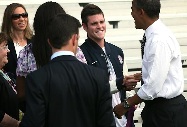 WASHINGTON, DC - SEPTEMBER 14: U.S. President Barack Obama (R) greets 2012 Olympic diving gold medalist David Boudia (2nd R) during a South Lawn event to welcome the 2012 U.S. Olympic and Paralympic teams September 14, 2012 at the White House in Washington, DC. Vice President Joseph Biden and first lady Michelle Obama join the president to host the athletes to honor their participation and success in this year's Olympic and Paralympic Games in London. (Photo by Alex Wong/Getty Images)