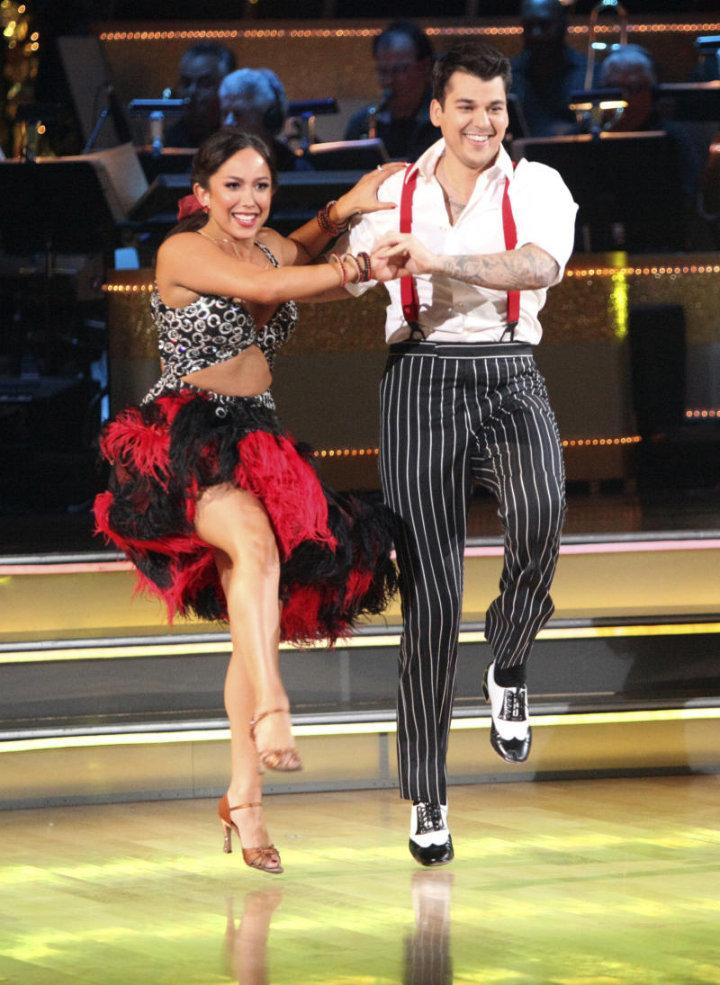 """FILE - In this Nov. 7, 2011 file photo released by ABC, Rob Kardashian, right, and Cheryl Burke perform on the celebrity dance competition series """"Dancing with the Stars,"""" in Los Angeles. Two routines stand between the three """"Dancing With the Stars"""" finalists and the show's disco-ball trophy. Reality star Rob Kardashian, TV personality Ricki Lake and actor and Army veteran J.R. Martinez will each perform two numbers on Monday's final dance-off. A new champion will be named Tuesday.  (AP Photo/ABC, Adam Taylor)"""