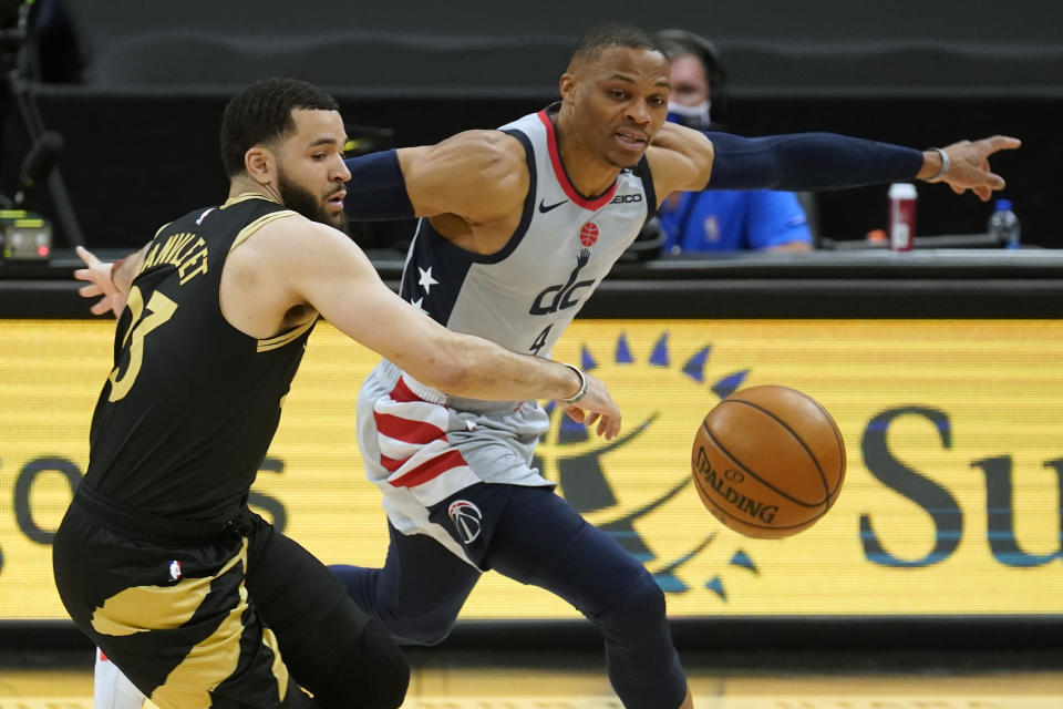 Washington Wizards guard Russell Westbrook (4) steals the ball from Toronto Raptors guard Fred VanVleet (23) during the first half of an NBA basketball game Thursday, May 6, 2021, in Tampa, Fla. (AP Photo/Chris O'Meara)