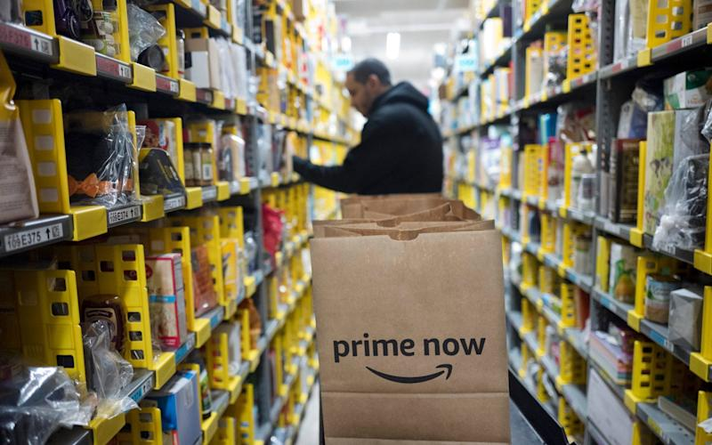 Amazon announced a second wage increase for its warehouse workers in the US - AP