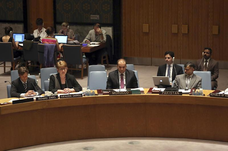 Associated Press Executive Editor Kathleen Carroll, second from left, addresses a United Nations Security Council meeting on the protection of civilians in armed conflict and the protection of journalists, Wednesday, July 17, 2013 at U.N. headquarters. (AP Photo/Mary Altaffer)