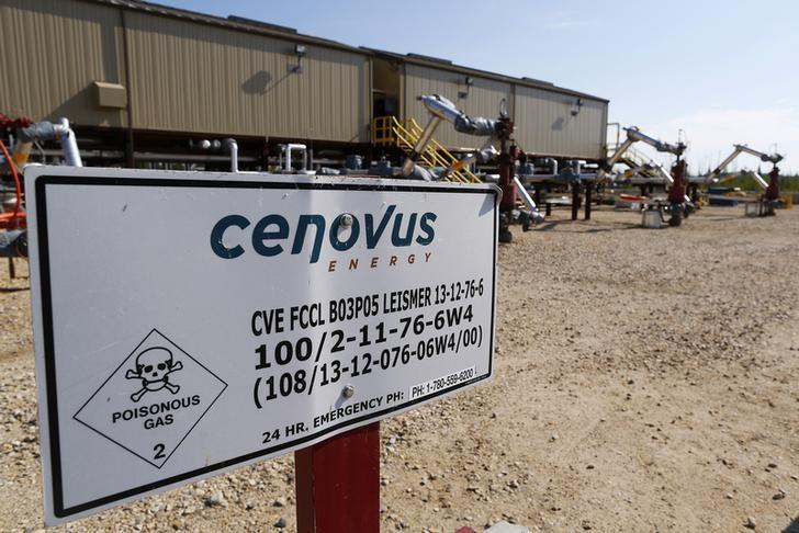 FILE PHOTO - A warning sign is pictured near well heads that inject steam into the ground and pump oil out at the Cenovus Energy Christina Lake SAGD project south of Fort McMurray