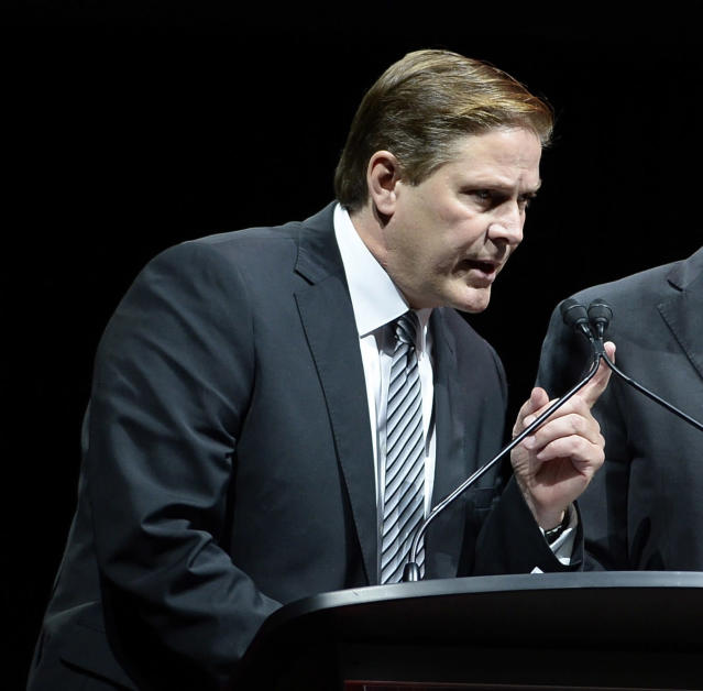 FILE - In this Aug. 24 2017, file photo, Ottawa Senators Assistant General Manager Randy Lee gestures while speaking at a memorial service for former coach and general manager of the Senators, Bryan Murray, at the Canadian Tire Centre in Ottawa. A person with direct knowledge of the situation tells The Associated Press that Ottawa Senators assistant general manager Randy Lee is being charged with harassment following an altercation that occurred during a shuttle bus ride back to his Buffalo hotel. The person spoke on the condition of anonymity to The AP on Friday morning, June 1, 2018, because Lee was scheduled to be arraigned in court later in the day. The person said Lee was arrested Thursday night after he was being transported back to his hotel from a downtown restaurant and bar. Lee is in town with other NHL team officials attending the league's annual pre-draft scouting combine, which runs through Saturday. (Justin Tang/The Canadian Press via AP, File)