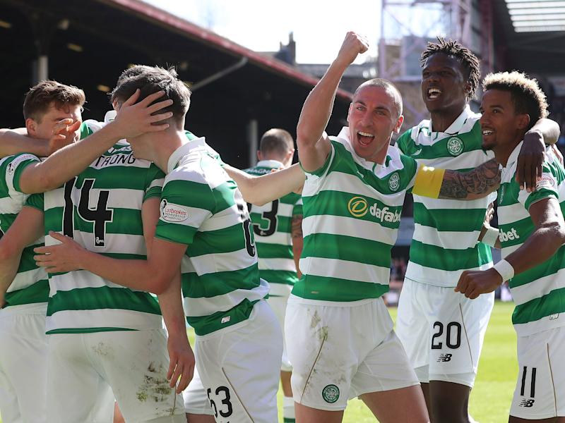 Stuart Armstrong celebrates scoring his team's third goal: Getty