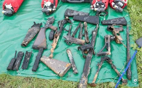 20 to 30 parts of firearms were discovered in Somerset after a man had been magnet fishing - Credit: SWNS.com