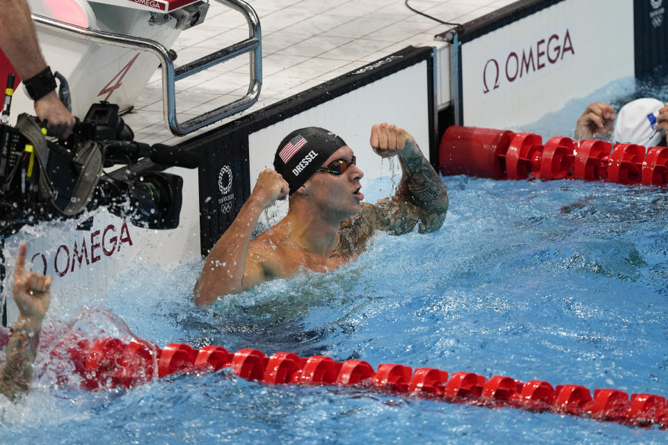 Caeleb Dressel, of the United States, celebrates after winning the gold medal in the men's 50-meter freestyle final at the 2020 Summer Olympics, Sunday, Aug. 1, 2021, in Tokyo, Japan. (AP Photo/Jae C. Hong)