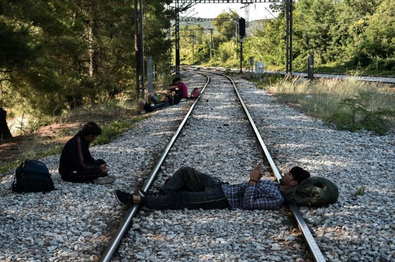 Migrants wait for a train to take them from Idomeni to a new life