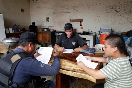 Vigilantes are seen at the command headquarters in the municipality of Coahuayana