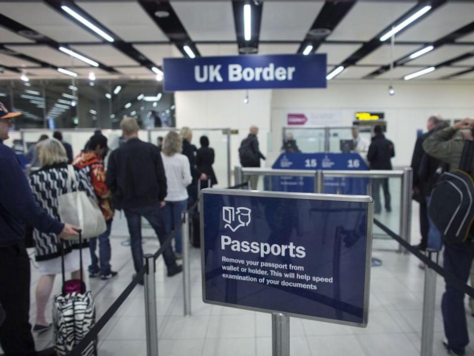 Border Force check the passports of passengers arriving at Gatwick Airport (Getty)