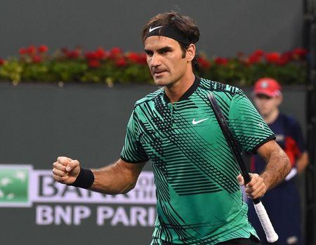 Mar 14, 2017; Indian Wells, CA, USA; Roger Federer (SUI) pumps his fist after match point as he defeats Steve Johnson (not pictured) 7-6, 7-6 in the BNP Paribas Open at the Indian Wells Tennis Garden. Mandatory Credit: Jayne Kamin-Oncea-USA TODAY Sports