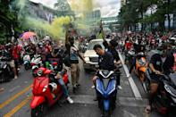 Protesters in cars and on bikes massed in Bangkok's central shopping district