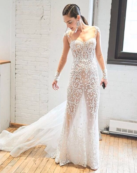 Bride wearing transparent naked sheer wedding gown
