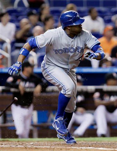 Toronto Blue Jays' Rajai Davis leaves the batter's box on a second-inning double during an interleague baseball game against the Miami Marlins in Miami, Friday, June 22, 2012. (AP Photo/Alan Diaz)
