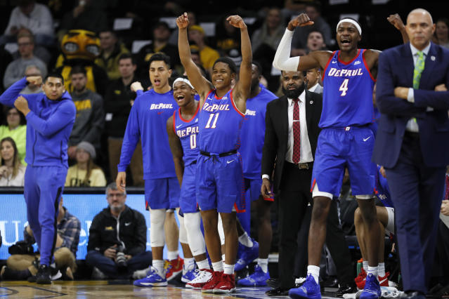 FILE - In this Nov. 11, 2019, file photo, DePaul guard Charlie Moore (11) and teammates celebrate on the bench during the first half of the team's NCAA college basketball game against Iowa in Iowa City, Iowa. The Blue Demons are 8-0 for the first time since the 1986-87 team won its first 16 games and turning heads in a way the once-proud program hasnt in years. With NCAA runner-up Texas Tech visiting on Wednesday, they could really open some eyes. DePaul already has road wins over Iowa, Boston College and Minnesota. (AP Photo/Charlie Neibergall, File)