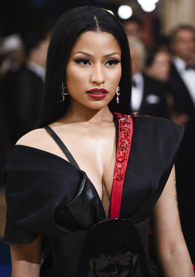 <p>The rapper Nicki Minaj's ruby-slipper lips, using Lust 004, tied into the train on her exaggerated gown. (Photo: AP) </p>
