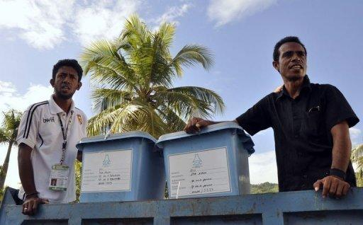 East Timorese election officials prepare to distribute ballot boxes in Dili