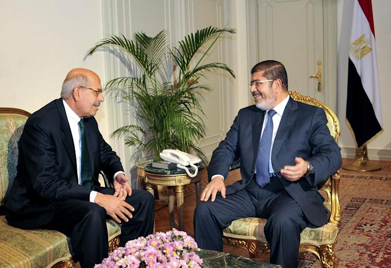 """FILE - In this Tuesday, Nov. 13, 2012 file photo, released by the Egyptian Presidency, Nobel Peace Prize winner and head of the opposition Egyptian Constitution political party, Mohamed ElBaradei, left, meets with Egyptian President Mohammed Morsi, in Cairo, Egypt. An Egyptian opposition leader is calling for a boycott of upcoming parliamentary elections, a day after he said the vote will inflame the country's political tensions. Mohamed ElBaradei, who leads the main opposition National Salvation Front, wrote on Twitter Saturday, Feb. 23, 2013 that he is calling for the boycott """"to expose sham democracy,"""" as he said he did in a similar call in 2010 under then-president Hosni Mubarak. ElBaradei says he urges the boycott of the vote called by Islamist President Mohammed Morsi because he """"will not be part of an act of deception."""" (AP Photo/Egyptian Presidency, File)"""