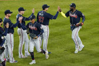 Atlanta Braves third baseman Austin Riley (27), left fielder Marcell Ozuna, right, and teammates celebrate after a baseball game against the New York Yankees, Wednesday, April 21, 2021, at Yankee Stadium in New York. The Braves won 4-1. (AP Photo/Kathy Willens)