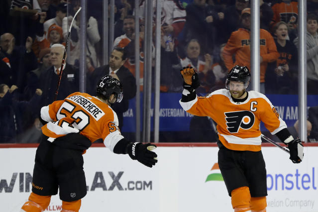 Philadelphia Flyers' Claude Giroux, right, and Shayne Gostisbehere celebrate after Giroux's goal during the second period of an NHL hockey game against the Edmonton Oilers, Saturday, Feb. 2, 2019, in Philadelphia. (AP Photo/Matt Slocum)