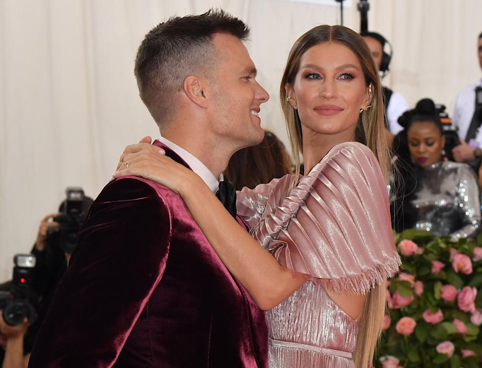 "Gisele Bundchen, pictured with her husband Tom Brady, says she doesn't like the term ""stepmom.""  (Photo: ANGELA WEISS/AFP via Getty Images)"