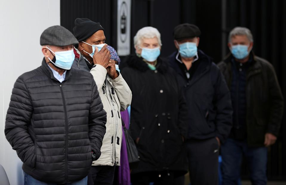 People queue as they wait to receive the COVID-19 vaccine at Crystal Palace Football Club Vaccination Centre, amid the outbreak of the coronavirus disease (COVID-19) in London, Britain February 4, 2021. REUTERS/Hannah McKay