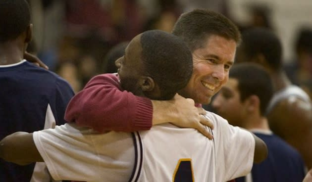 Collingswood coach Joe McLoughlin celebrates a victory with a player — Philadelphia Inquirer