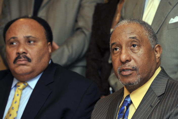FILE - In this March 6, 2010, file photo, Southern Christian Leadership Conference spokesman Bernard LaFayette, right, speaks to reporters as Martin Luther King III, left, looks on in Atlanta. LaFayette attended nonviolence workshops led by Rev. James Lawson during the civil rights struggles of the 1960s. (AP Photo/Gregory Smith)