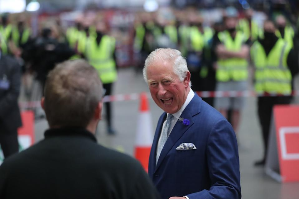 BELFAST, NORTHERN IRELAND - SEPTEMBER 30: Prince Charles, Prince of Wales laughs with foodservice driver Stephen Taggart during a visit to the Henderson Group's food and grocery distribution centre in Newtownabbey on September 30, 2020 near Belfast, United Kingdom. During his visit, the prince thanked staff for their efforts during the coronavirus pandemic, during which they were met with unprecedented demand. (Photo by Niall Carson - WPA Pool/Getty Images)