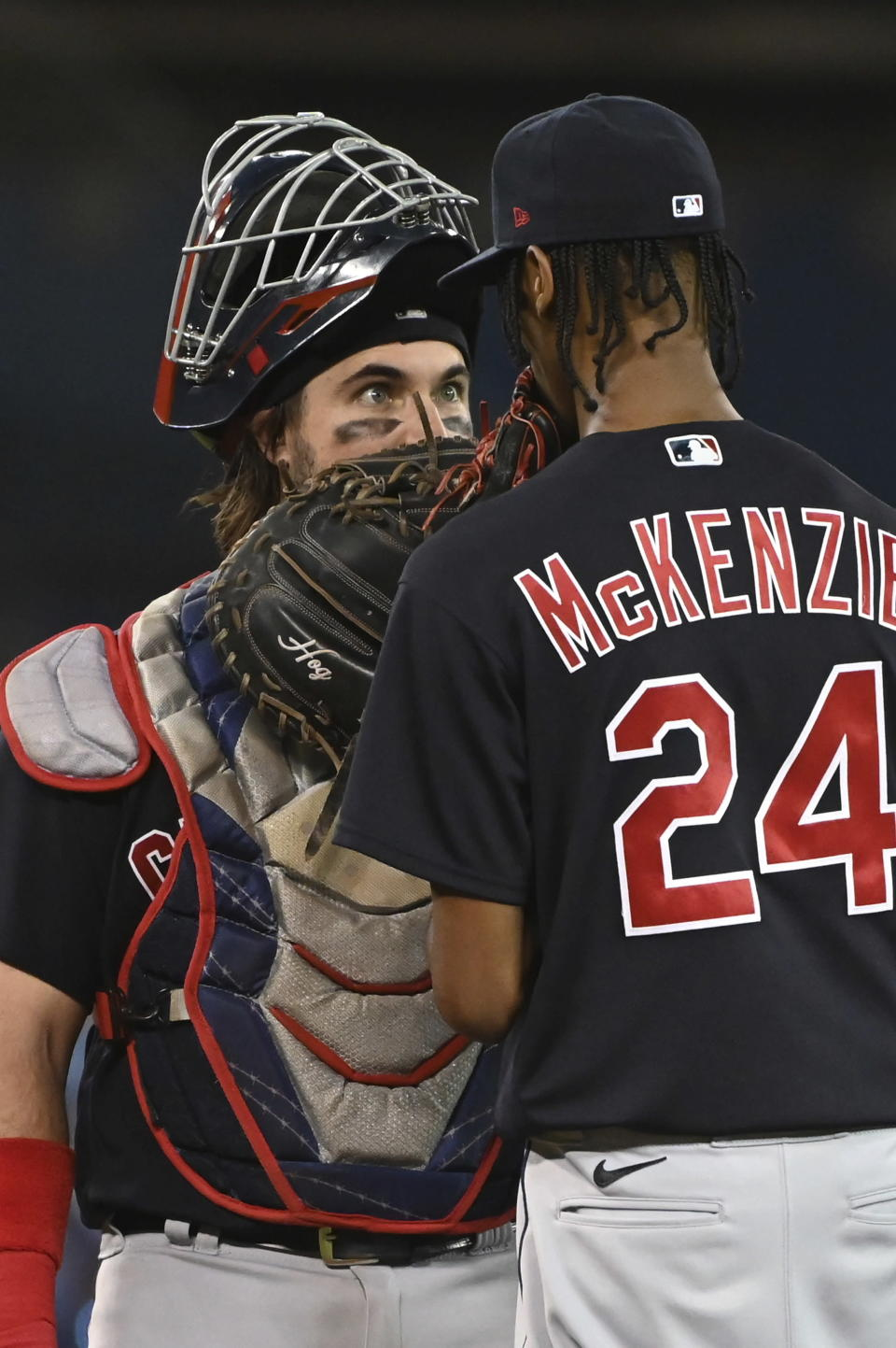 Cleveland Indians catcher Austin Hedges, left, visits the mound to talk to pitcher Triston McKenzie during the sixth inning of a baseball game against the Toronto Blue Jays on Thursday, Aug. 5, 2021, in Toronto. (Jon Blacker/The Canadian Press via AP)