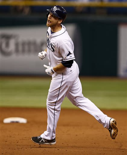 Tampa Bay Rays' Ben Zobrist celebrates after hitting a game-winning single in the 13th inning of a baseball game against the Minnesota Twins Wednesday, July 10, 2013, in St. Petersburg, Fla. The Rays won 4-3. (AP Photo/Mike Carlson)