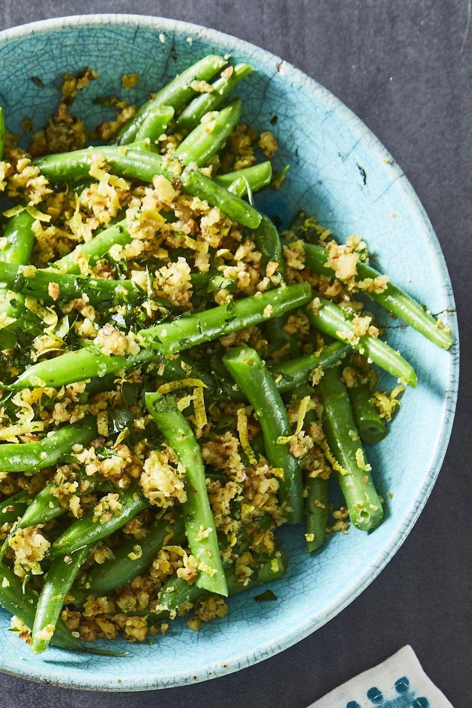 """<p>Turn simple green beans into something special with an almond, olive, parsley, and lemon zest tapenade.</p><p><em><a href=""""https://www.goodhousekeeping.com/food-recipes/healthy/a44181/green-beans-olive-almond-tapenade-recipe/"""" rel=""""nofollow noopener"""" target=""""_blank"""" data-ylk=""""slk:Get the recipe for Green Beans with Olive-Almond Tapenade »"""" class=""""link rapid-noclick-resp"""">Get the recipe for Green Beans with Olive-Almond Tapenade »</a></em></p>"""