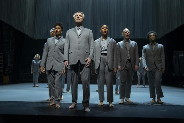 """David Byrne in a production still from """"David Byrne's American Utopia."""" Directed by Oscar® and Emmy® winning director Spike Lee, theone-of-a-kind, dynamic film gives audiences around the world access to Byrne'selectrifying Broadway show that played to sold-out, record-breaking audiences during itsrun from October 2019 to February 2020 at Broadway's Hudson Theater."""