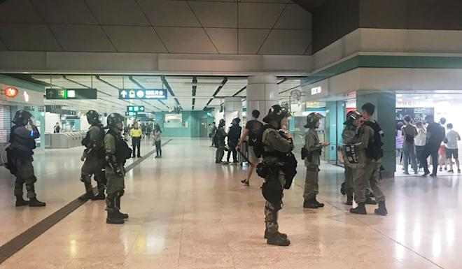 Riot police at Siu Hong MTR station on Sunday. Photo: Rachel Smyth