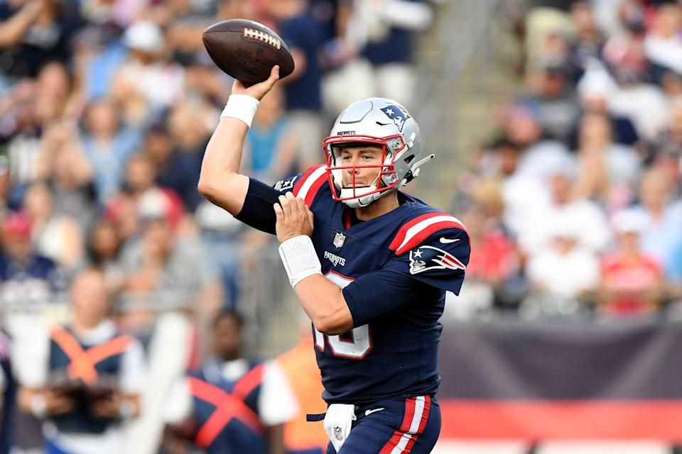 New England Patriots quarterback Mac Jones throws the ball against the Miami Dolphins during the second half at Gillette Stadium in Foxboro on Sunday, Sept. 12, 2021.