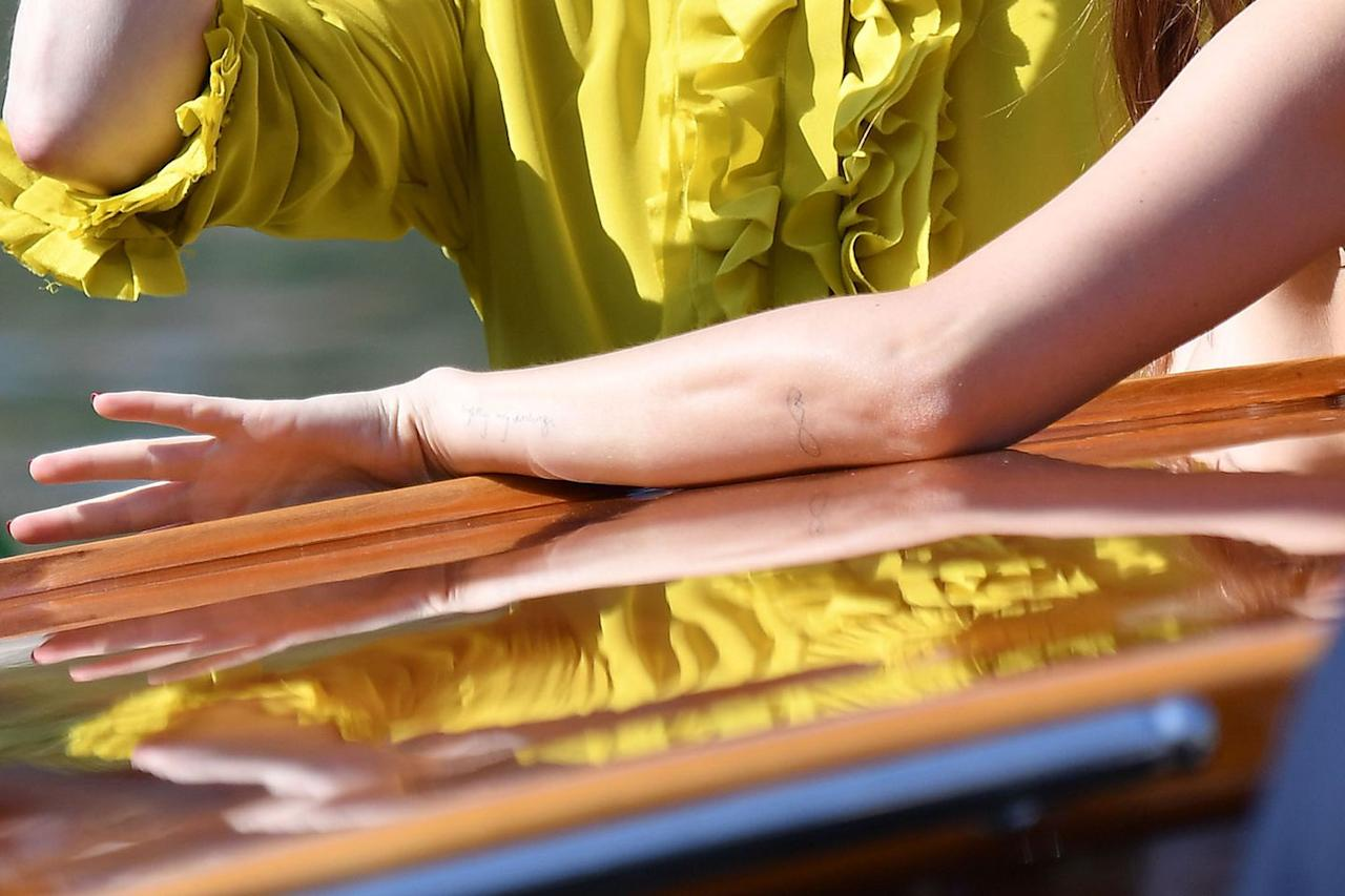 <p>Dakota Johnson was showing off some new ink while promoting the <em>Suspiria</em> remake at the 2018 Venice International Film Festival. The infinity symbol with two x's matches one that her beau, Chris Martin, also has. The significance of the x's is unclear, but infinity usually symbolizes eternal love.</p>