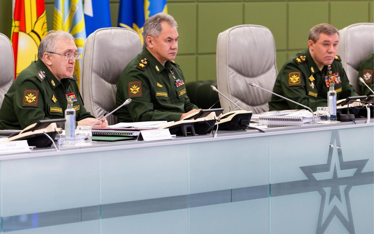 Defence minister Sergei Shoigu, centre, orders top brass to develop a new hypersonic missile and modify an exisiting cruise missile for land use - TASS