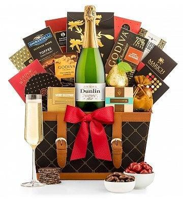 """<h2>Champagne Wishes Gift Basket</h2><br>Send a virtual toast with this elegant combo of champagne and high-quality snacks; the ideal gifting move for holidays spent away from family and friends. <br><br><strong><em><a href=""""https://fave.co/2Uv15lZ"""" rel=""""nofollow noopener"""" target=""""_blank"""" data-ylk=""""slk:Shop Gift Tree"""" class=""""link rapid-noclick-resp"""">Shop Gift Tree</a></em></strong><br><br><strong>Gift Tree</strong> Champagne Wishes Gift Basket, $, available at <a href=""""https://go.skimresources.com/?id=30283X879131&url=https%3A%2F%2Ffave.co%2F336LePB"""" rel=""""nofollow noopener"""" target=""""_blank"""" data-ylk=""""slk:Gift Tree"""" class=""""link rapid-noclick-resp"""">Gift Tree</a>"""