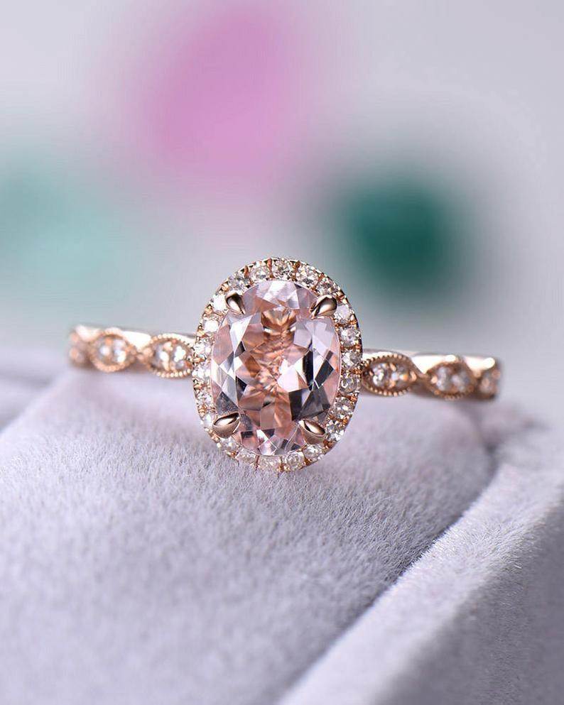 """<p>You can spot the <a href=""""https://www.popsugar.com/buy/Rose-Gold-Oval-Cut-Natural-Morganite-Engagement-Ring-CZ-Diamond-Halo-531223?p_name=Rose%20Gold%20Oval%20Cut%20Natural%20Morganite%20Engagement%20Ring%20With%20CZ%20Diamond%20Halo&retailer=etsy.com&pid=531223&price=197&evar1=fab%3Aus&evar9=7954958&evar98=https%3A%2F%2Fwww.popsugar.com%2Fphoto-gallery%2F7954958%2Fimage%2F47020640%2FRose-Gold-Oval-Cut-Natural-Morganite-Engagement-Ring&list1=shopping%2Cwedding%2Cjewelry%2Crings%2Cbride%2Cengagement%20rings%2Cfashion%20shopping&prop13=api&pdata=1"""" rel=""""nofollow noopener"""" class=""""link rapid-noclick-resp"""" target=""""_blank"""" data-ylk=""""slk:Rose Gold Oval Cut Natural Morganite Engagement Ring With CZ Diamond Halo"""">Rose Gold Oval Cut Natural Morganite Engagement Ring With CZ Diamond Halo </a> ($197) from a mile away - it's so beautiful! </p>"""