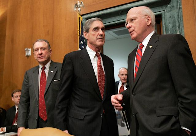 <p>FBI Director Robert Mueller, center, talks with Senate Judiciary Committee Chairman Sen. Patrick Leahy, D-Vt., right, as Sen. Arlen Specter, R-Pa., the committee's ranking Republican, looks on, prior to the start of a the committee's hearing on the FBI, Tuesday, March 27, 2007, on Capitol Hill in Washington. (Photo: Susan Walsh/AP) </p>