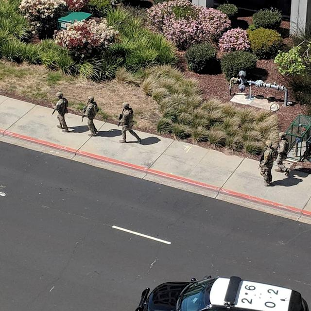 <p>Law enforcement officials react following a shooting at the headquarters of YouTube in San Bruno, Calif. on April 3, 2018. (Photo: Graeme Macdonald/Via Reuters) </p>