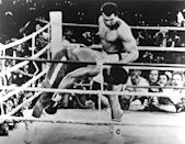 """<p>ZAIRE,AFRICA – OCTOBER 30,1974: Muhammad Ali lands a left hook knocking out George Foreman during the """"Rumble in the Jungle"""" fight at the Mai 20 Stadium on October 30,1974 in Kinshasa,Zaire. Muhammad Ali won WBC heavyweight title and the WBA World heavyweight title W KO 8. (Photo by: The Ring Magazine/Getty Images)</p>"""